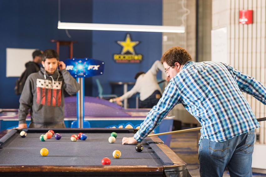 Students shooting pool in the Campus Center's game room.