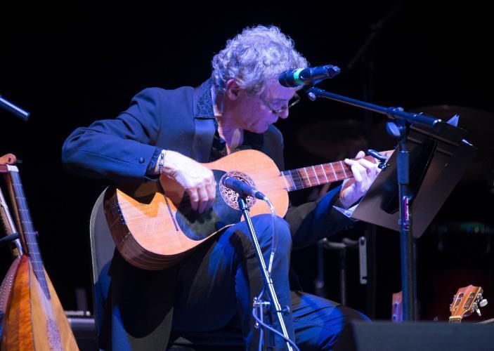 John T. La Barbera plays the guitar
