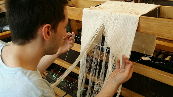 Christopher Rogers working at loom