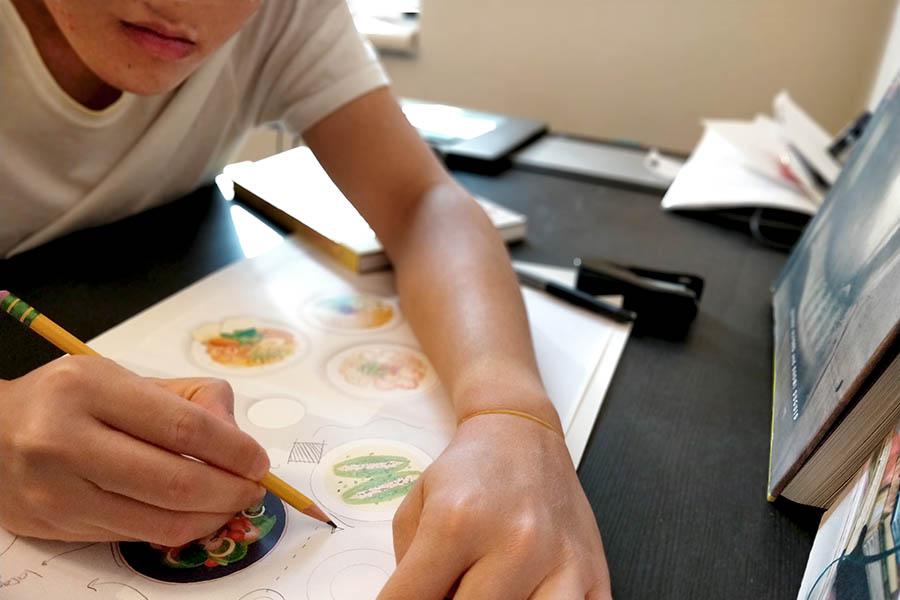 Tri Minh Mai working in studio