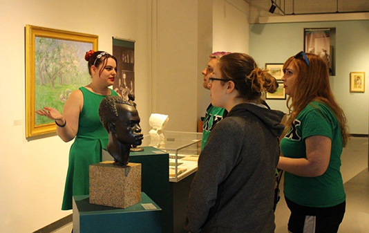 An Art History major gives a tour of the CVPA gallery.