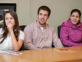 3 students at an Enactus weekly meeting in 2012