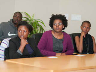 4 students at an Enactus weekly meeting in 2012