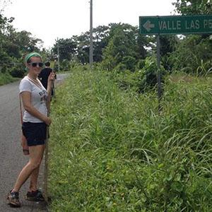 Casey Snook standing beside sign, 200x200