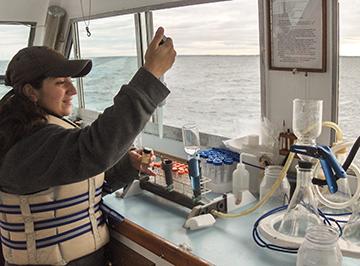 Christian Petitpas sampling Buzzards Bay water