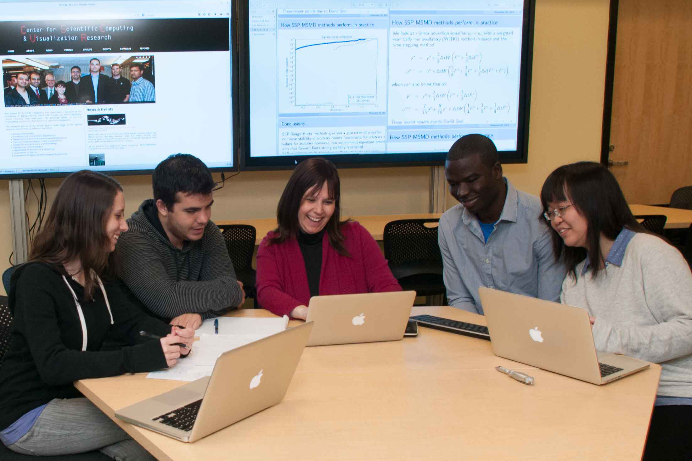 Sigal Gottlieb working with grad students at UMass Dartmouth's Center for Scientific Computing and Visualization Research (CSCVR).