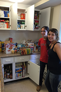 Katrina Martel and Gabrielle Monteiro at the Students Helping Students food pantry