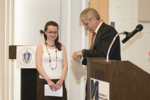 A student receives an award.