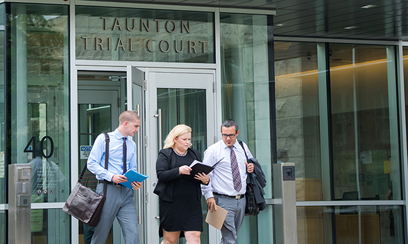 Students and alum outside Taunton Trial Court