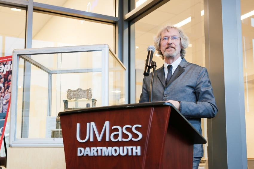 CCB professor at podium