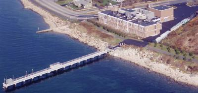 Aerial photo of SMAST building with full pier
